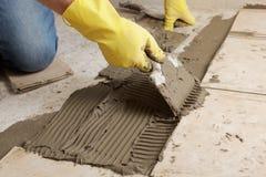 Installing ceramic tiles on a floor Stock Photos