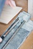Tiler installs ceramic tiles Royalty Free Stock Images