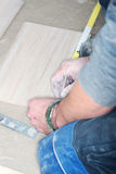 Tiler installs ceramic tiles Royalty Free Stock Photography