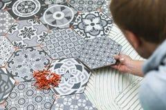 Tiler laying floor tiles Stock Image