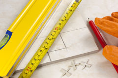 Tiler measured tiles for cutting Royalty Free Stock Photography