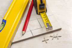 Tiler preparation for cutting tiles Royalty Free Stock Image