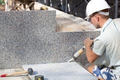 Tiler sealing joints between ceramic tiles. Construction worker sealing joints between ceramic tiles stock images