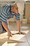 Tiler - Tile Floor. Working tiller Stock Photos