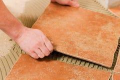 Tiler tiling tiles on the floor Stock Photography