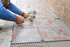 Tiler to work with tile flooring Stock Images