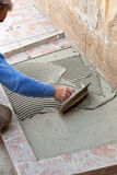 Tiler to work with tile flooring Stock Photo
