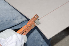 Tiler using a tile nipper Royalty Free Stock Photography