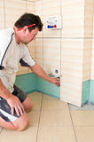Tiler at work Royalty Free Stock Image