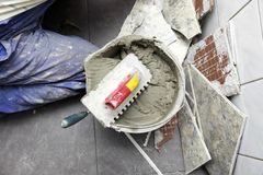 Tiler at work bonding of floor  tile adhesive Royalty Free Stock Photo