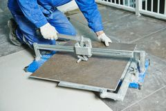 Tiler working with tile cutting equipment Royalty Free Stock Photography