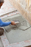 Tiler works with flooring. Stock Photo