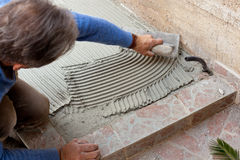 Tiler works with flooring. Royalty Free Stock Images