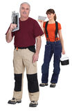 Tiler and young female assistant royalty free stock photos