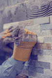 Tilers hands gluing brick decorations Royalty Free Stock Photography