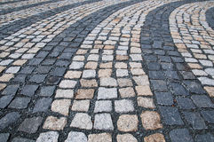Tiles. Street tiles forming curved lines Stock Image