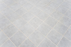 Tiles. Grey floor tiles in hallway Stock Image
