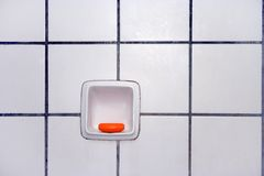 Tiles from bathroom. Bathroom with white tiles with soap red Royalty Free Stock Photo