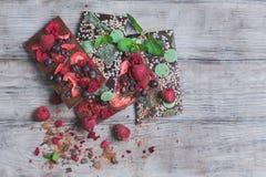 Tiles of a broken exquisite hand-made chocolate Stock Photos