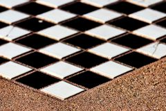 Tiles chess board inlaid on a concrete table stock photo