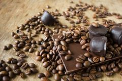 Tiles of dark chocolate candy coffee beans Royalty Free Stock Image