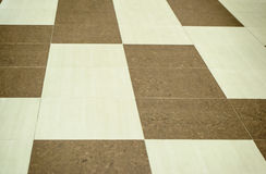 Tiles of different colors on the floor. In the mall Stock Image