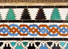 Tiles glazed, Alcazar Royal palace in Sevilla, Spain. Moorish Art, glazed tile skirting board, palace royal Alcazar in Seville, Andalusia, Spain Royalty Free Stock Photo