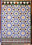 Tiles glazed, azulejos, Alcazar Royal palace in Sevilla, Spain. Moorish Art, glazed tile skirting board, palace royal Alcazar in Seville, Andalusia, Spain Royalty Free Stock Photo