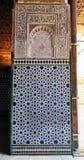 Tiles glazed, azulejos, Alcazar in Sevilla, Spain. Arab Art, detail of decoration of the palace royal Alcazar in Seville, Andalusia, Spain Royalty Free Stock Photo