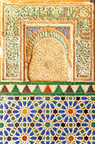 Tiles glazed and plasterwork, Alcazar Royal palace in Sevilla, Spain. Mudejar Art, glazed tile skirting board, palace royal Alcazar in Seville, Andalusia, Spain Stock Photos