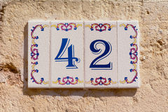 Tiles for house number 42 Stock Photography