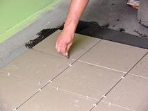 Tiles installation. On the floor in home renovation work stock images
