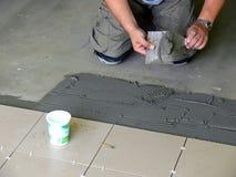 Tiles installation Royalty Free Stock Photo