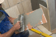 Tiles installation. On the wall Royalty Free Stock Photos