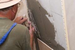 Tiles installation. On the wall Stock Photo