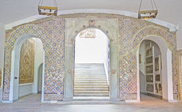 The tiles in interior. TUNIS, TUNISIA - SEPTEMBER 2, 2015: The hall of Bardo National Museum decorated with arched passes, covered with tiles, on September 2 in Stock Photos