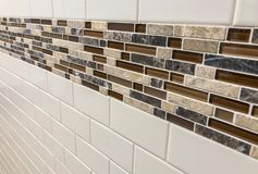 Tiles made of glass and stone installed on the wall as decoration or kitchen backsplash. Tiles made of glass installed on the wall as decoration or kitchen stock image