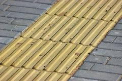Tiles for people with visual disabilities. convenient city, the ability to move for people with disabilities. textured pattern on royalty free stock photography