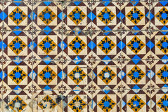 Tiles of Portugal. Ceramics - old square blue, brown and black tiles of Portugal Royalty Free Stock Photo