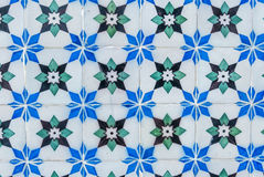 Tiles of Portugal. Ceramics - old square blue, white, green and black tiles of Portugal Stock Photos