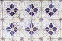 Tiles of Portugal. Ceramics - old square purple tiles of Portugal Royalty Free Stock Photo