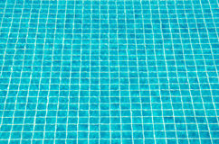 Tiles on swimming pool ground texture. Tiles on swimming pool ground, background texture Royalty Free Stock Images