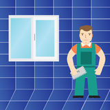 Tiles and tiler in the bathroom. Royalty Free Stock Image