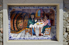 Tiles with two men drinking in Alte Stock Photography