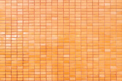 Tiles used for the background. Orange tiles wall used for the background Stock Photos