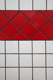 Tiles white and red. Vertical and oblique tiles with black tile joint Stock Photography