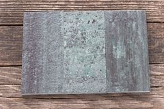 Tiles on wooden background Royalty Free Stock Photo