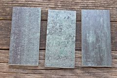 Tiles on wooden background Stock Photography
