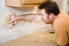 Tilesetter Wipes Down Tile Royalty Free Stock Images