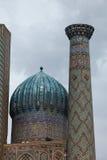 Tilework splendor. Dome and tower in samarkand, uzbekistan stock photography